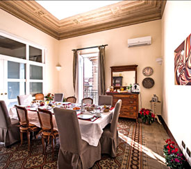 Visit the breakfast room of theB&B Novecento in Palermo
